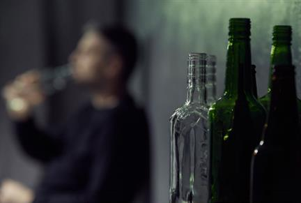 Bottles with man in background